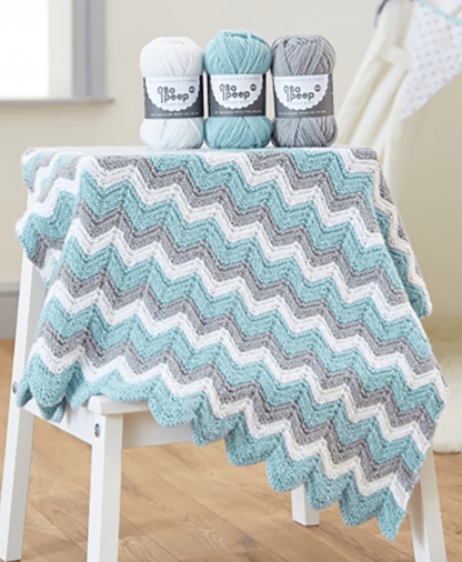 West Yorkshire Spinners Knitted Zig Zag Baby Blanket Pattern in Bo Peep DK
